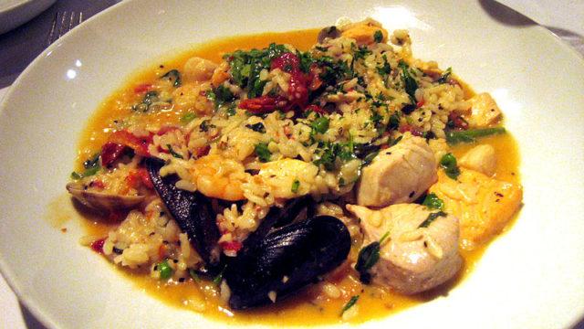 Italian seafood with rice plate, called Risotto Alla Marinara. Wikipedia
